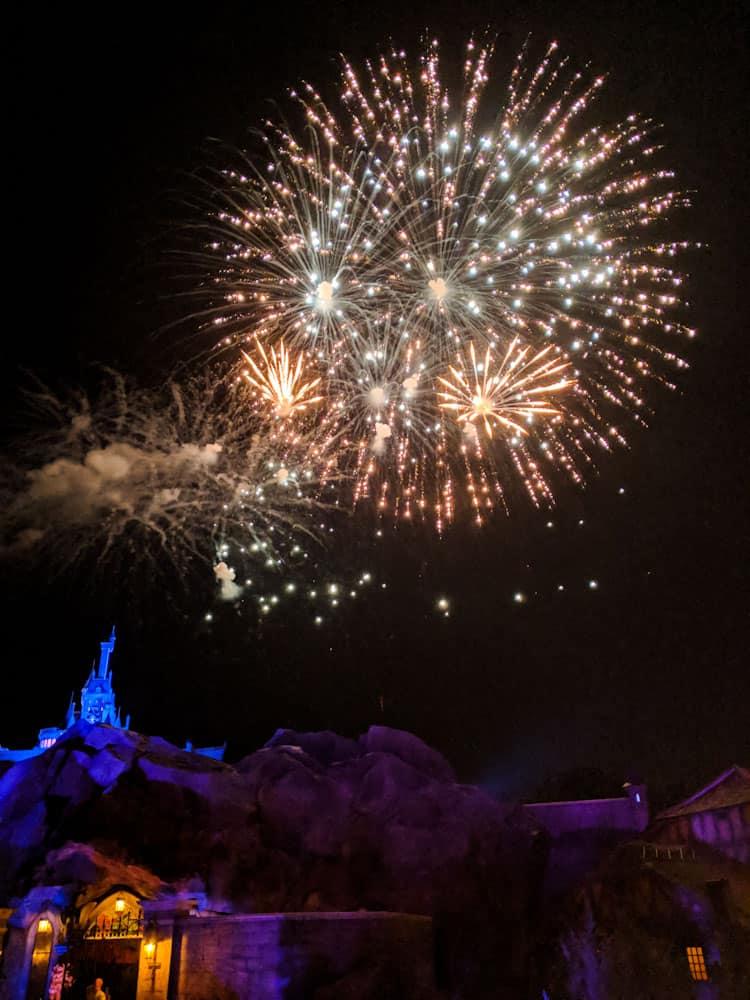 Mickey's Very Merry Christmas Party fireworks over Beast's Castle