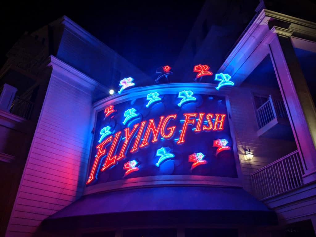 Image of Disney's Flying Fish entrance at night
