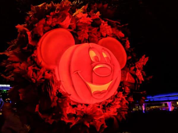 Mickey pumpkin glowing at night in Magic Kingdom
