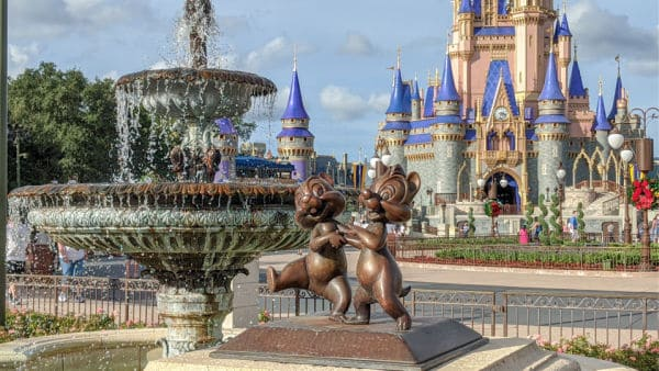 Chip and Dale statue in foreground, fountain and Cinderella Castle in background
